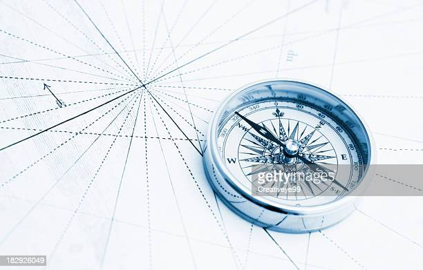 blue compass high key - compass stock pictures, royalty-free photos & images