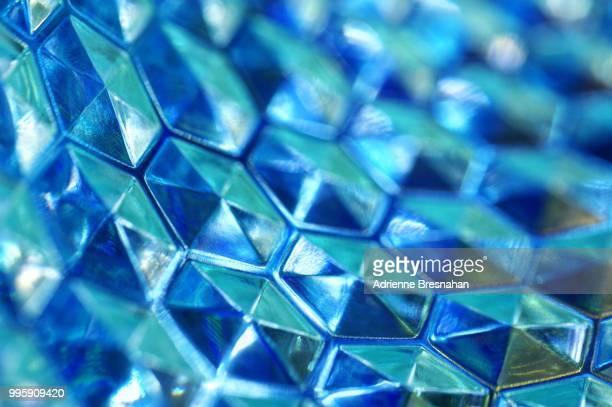 blue concave hexagon background - geometriestunde stock-fotos und bilder