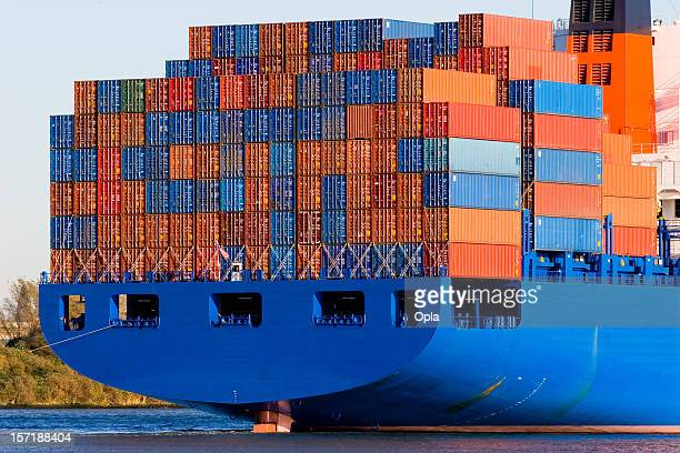 Blue containership with cargo containers
