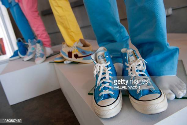 """Blue converse All-Star worn by K-pop BTS band member V on their """"Dynamite"""" music video are displayed at the MusiCares Charity Relief auction Press..."""