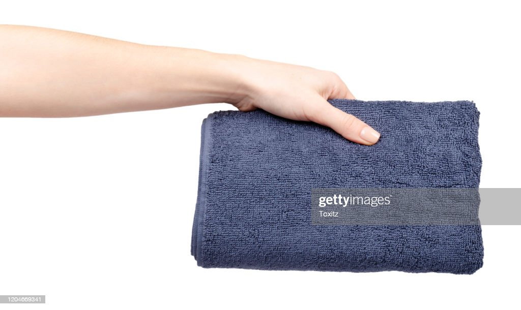 Blue cotton towel in hand. Isolated on white. : Stock Photo