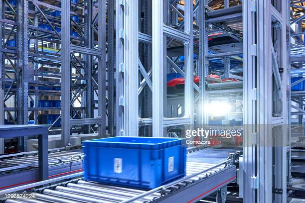 blue crate on conveyor belt at distribution warehouse - big data storage stock pictures, royalty-free photos & images