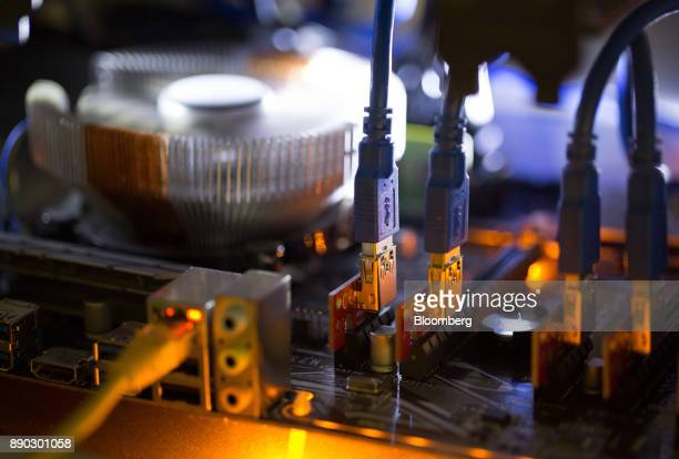 Blue data connector cables sit on a circuit board used in cryptocurrency mining machines at the SberBit mining 'hotel' in Moscow Russia on Saturday...