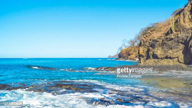 a blue day in playa hermosa, guanacaste - costa rica - guanacaste stock pictures, royalty-free photos & images