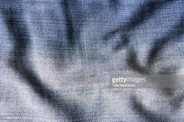 blue denim rumpled fabric can be used as background - fringe stock pictures, royalty-free photos & images