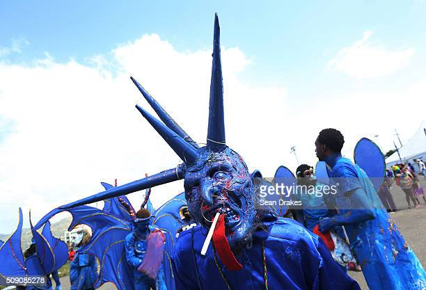 Blue Devil from the band 'Devils on the Loose' prepares to compete in the Parade of Bands in the Queen's Park Savannah as part of Trinidad and Tobago...