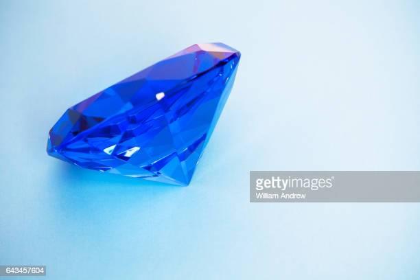 Blue diamond on blue background