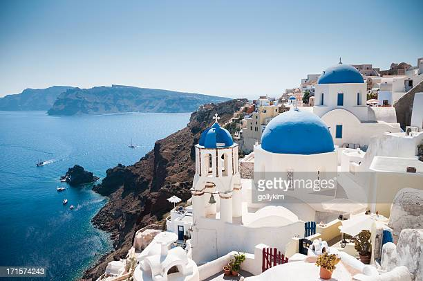 Blue domed church along caldera edge in Oia, Santorini