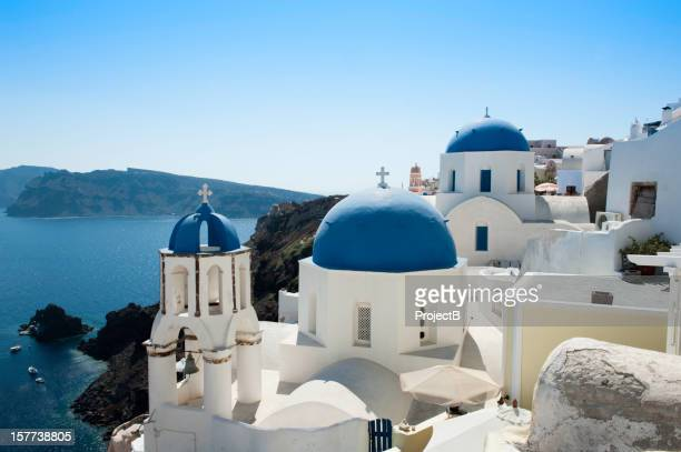 blue domed church with white washed houses in santorini, greece - greek orthodoxy stock pictures, royalty-free photos & images