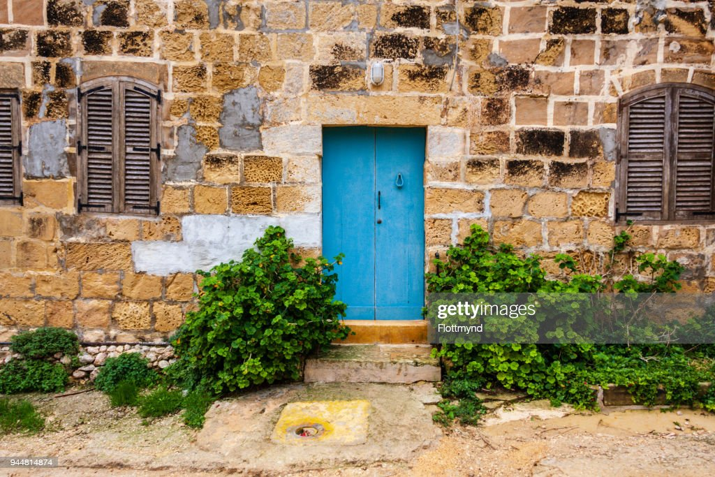 Blue door in a weathered house, in Gozo, Malta : Stock Photo