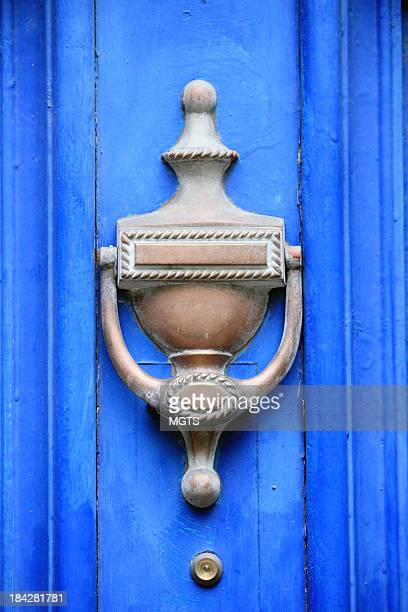blue door knocker - door knocker stock photos and pictures