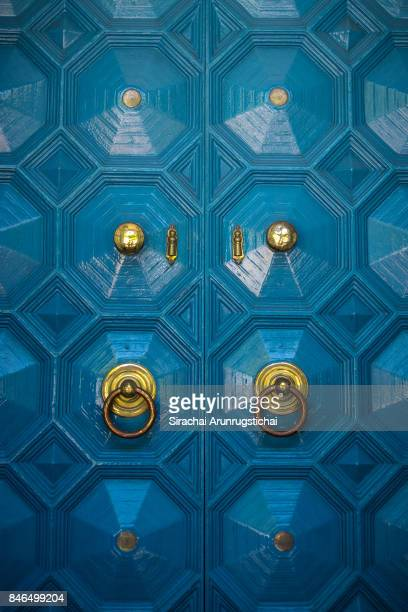 Blue door with gold decoration