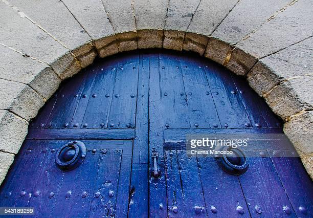 Blue door with knockers