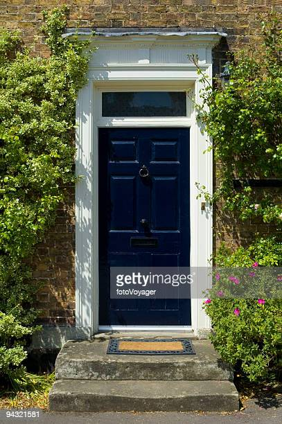 blue door with welcome mat - georgian style stock pictures, royalty-free photos & images