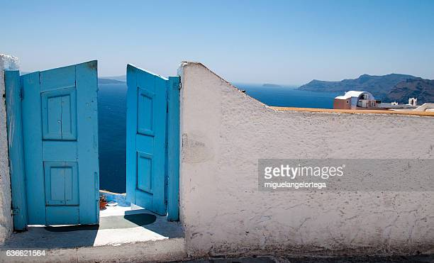 blue doors in ia - muro stock photos and pictures