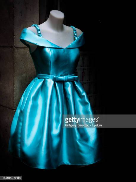 Blue Dress In Mannequin Against Wall