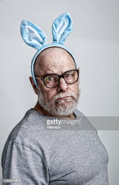 blue easter bunny ears senior adult man cancer patient side effects - easter bunny costume stock pictures, royalty-free photos & images