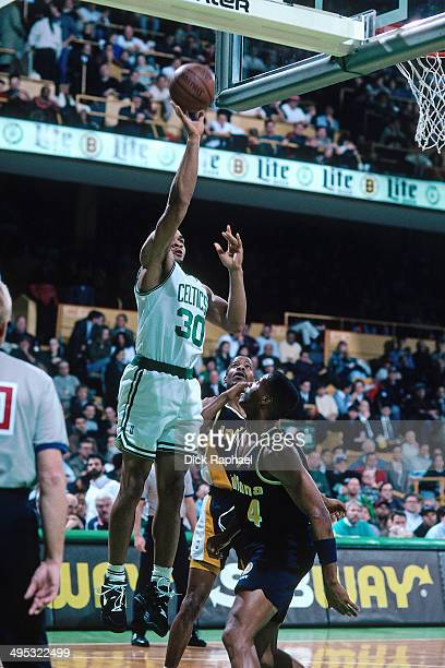 Blue Edwards of the Boston Celtics shoots against Travis Best of the Indiana Pacers during a game played in 1995 at the Boston Garden in Boston...