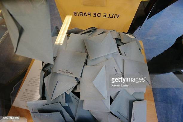 Blue envelopes are stacked in the 20th district as French voters go to the polls to vote in the municipal elections on March 23 2014 in Paris France...
