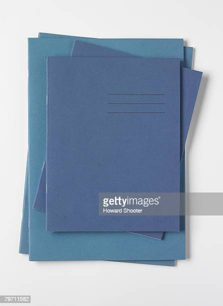 blue exercise books, studio shot - workbook stock photos and pictures