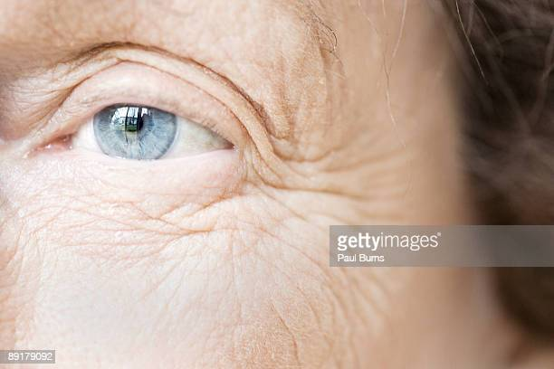 blue eye of elderly woman - wrinkled stock pictures, royalty-free photos & images