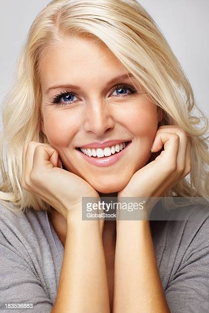 Blue eyed woman with hands on chin