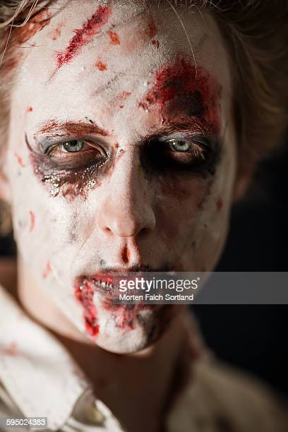 blue eyed zombie - zombie makeup stock photos and pictures