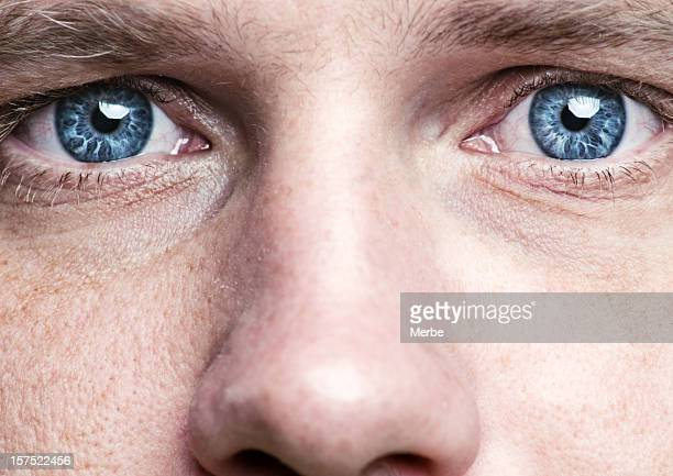 blue eyes - extreme close up stock pictures, royalty-free photos & images