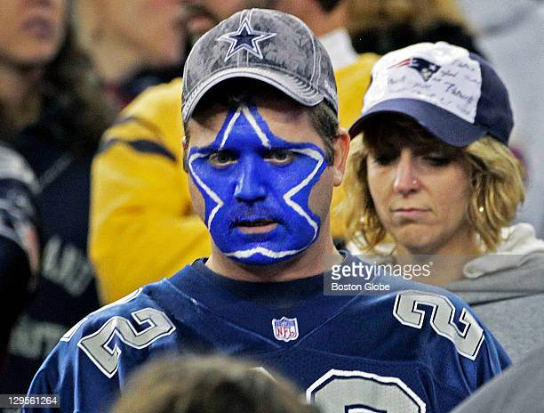 A blue face painted Cowboys fan isn't too happy near the end of the Dallas loss to New England The New England Patriots hosted the Dallas Cowboys in...