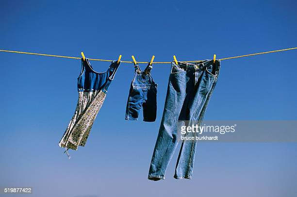 blue family clothes on clothesline - blue dress stock pictures, royalty-free photos & images