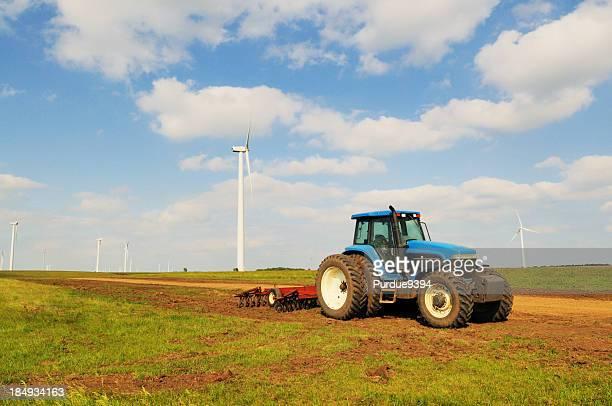 Blue Farm Tractor and Cultivator with Wind Turbine South Dakota