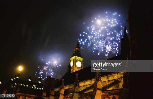 Blue fireworks exploding over the Houses of Parliament and Big Ben as part of New Year's Eve celebrations to mark the new Millenium, 31st December...
