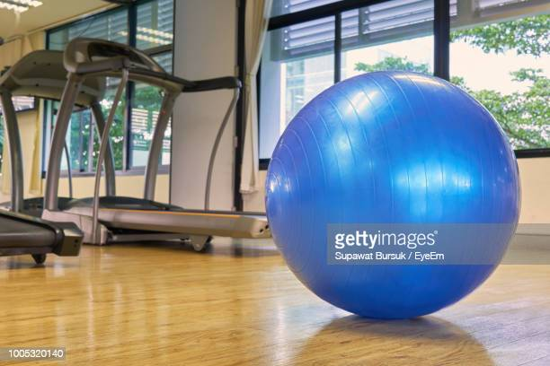 blue fitness ball in gym - fitness ball stock pictures, royalty-free photos & images