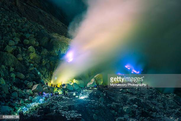blue flame at night in the ijen crater - active volcano stock pictures, royalty-free photos & images