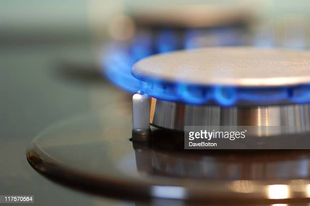 Blue flame coming from a burner on a gas stove