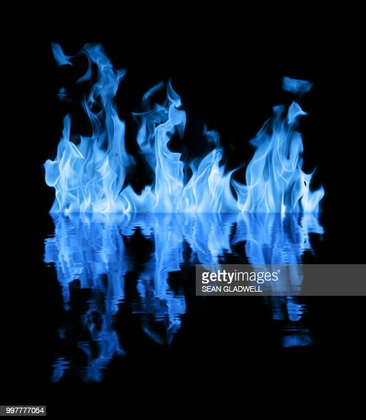 blue flames on water - flame stock pictures, royalty-free photos & images