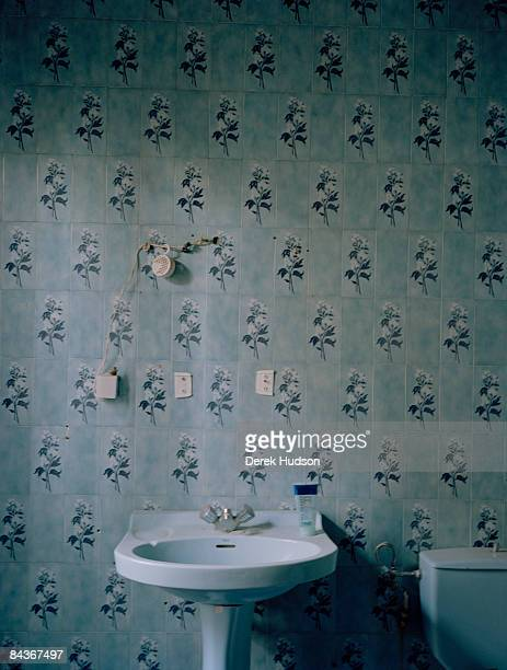 A blue flower patterned tile bathroom in an abandoned building in the Marshan district of Tangier