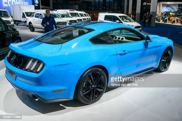 Blue Ford Mustang American muscle car rear view on display at Brussels Expo on January 13, 2017 in Brussels, Belgium. The sixth generation of the...