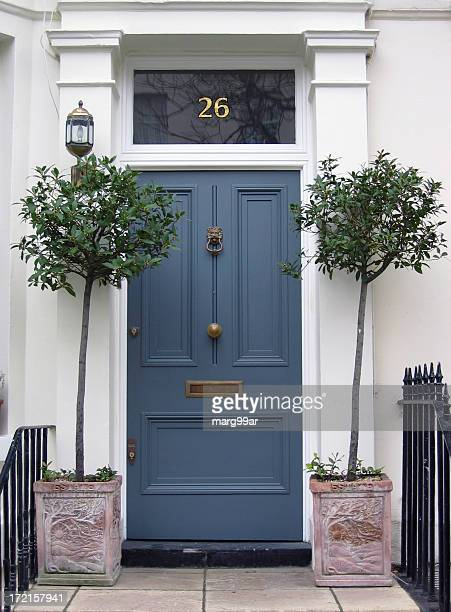 blue front door - door knocker stock photos and pictures