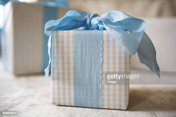 blue gingham gift with blue ribbon - baby shower stock photos and pictures
