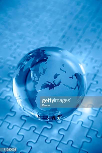 Blue globe on jigsaw puzzle