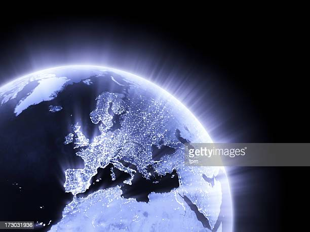 blue glowing earth crop [europe] - cartography stock photos and pictures