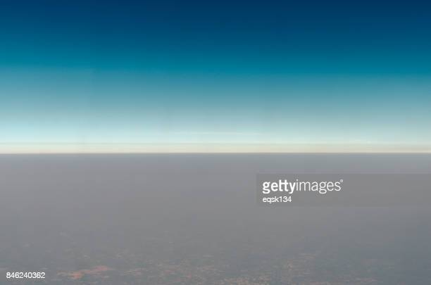 Blue Gradient Sky with the mist above the city (Aerial View)