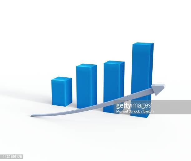 blue graph and arrow symbol against white background - bar graph stock pictures, royalty-free photos & images