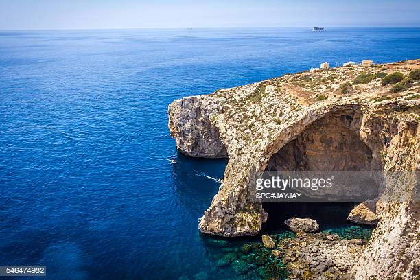 blue grotto of malta from wied iż-żurrieq - 青の洞窟 ストックフォトと画像