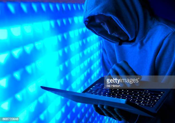blue hacker - evil stock photos and pictures