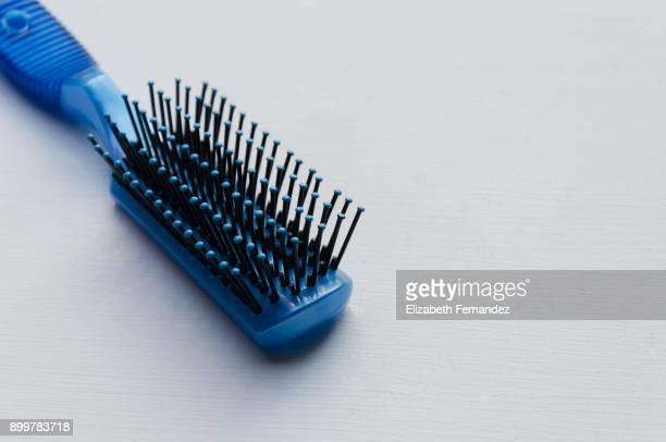 blue hairbrush on white - 箒 ストックフォトと画像