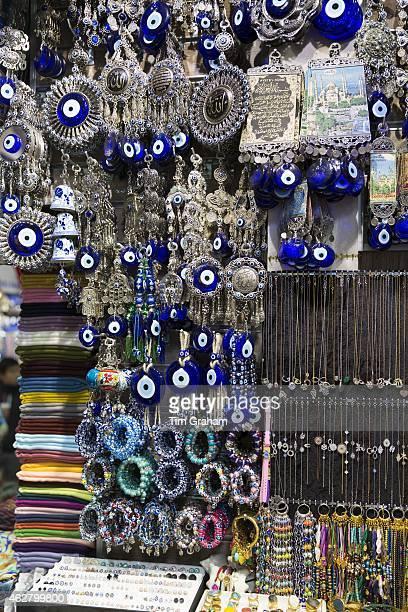 Blue Hamsa Turkish Evil Eye beads pendants and trinkets in The Grand Bazaar Kapalicarsi great market Beyazi Istanbul Turkey