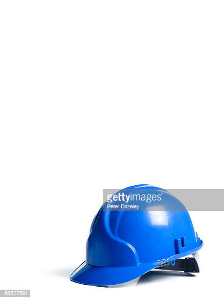 blue hard hat on white background - schutzhelm stock-fotos und bilder