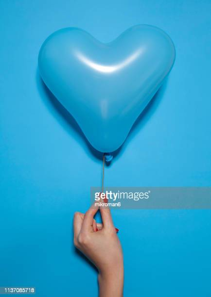 blue heart shaped balloon - february background stock pictures, royalty-free photos & images